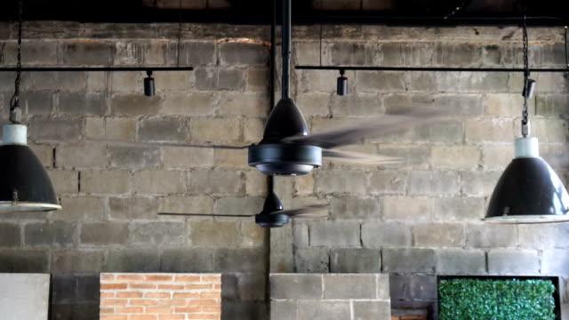 fhd slow motion footage of traditional ceiling fan slowly spins - moneta da 5 centesimi statunitensi video stock e b–roll