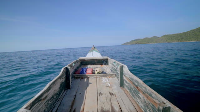 slow motion footage of wooden boat sailing on sea against blue sky, nautical vessel over water during sunny day - lombok, bali - nautical vessel点の映像素材/bロール