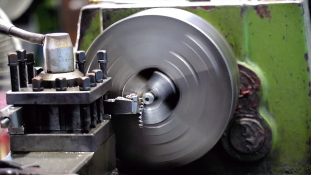 4k slow motion footage scene closeup working of lathes machine in metalworking factory, lathe metal working industry concept - machine part stock videos and b-roll footage