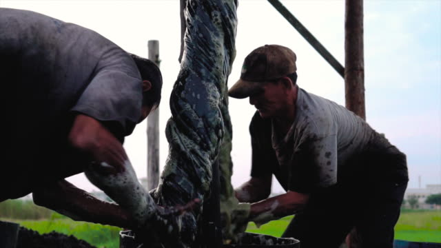 4k slow motion footage scene of vietnamese workers dyeing silk when sunrise in tan chau village, an giang, vietnam, latest village of ancient culture to dyed, tradition and conservation culture concept - navy blue stock videos & royalty-free footage