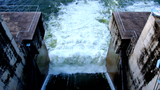 Slow motion footage top view of Hydroelectric Dam spillway in Thailand