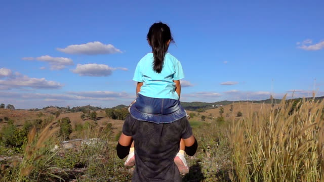 Slow motion Freedom of Father and daughter Play Airplane Arms Raised Together