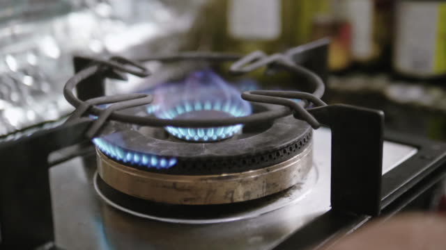 slow motion : gas hobs at home. - camping stove stock videos and b-roll footage