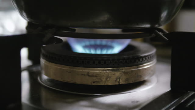 slow motion : gas stove with blue flame - camping stove stock videos and b-roll footage