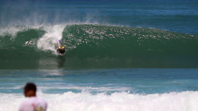 slow motion girl bodyboarder in helmet catching a wave in pipeline, hawaii - catching stock videos & royalty-free footage