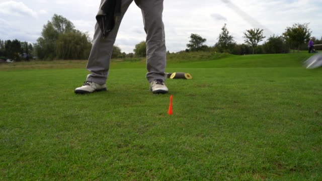 slow motion golf swing. - golf swing on white stock videos & royalty-free footage