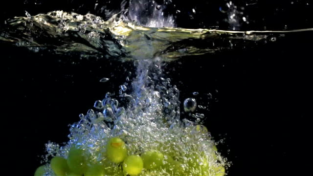 slow motion grape falling underwater - grape stock videos & royalty-free footage