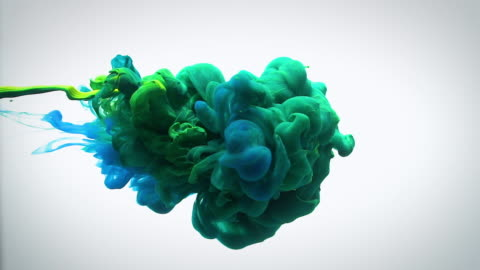 slow motion green blue and yellow ink flow in water. - mixing stock videos & royalty-free footage