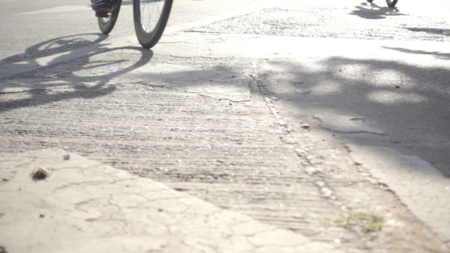 Slow motion : group of riders passing by