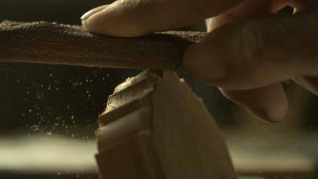 slow motion guitar head being sanded, spain, cu (individual frames may also be used as a still image. each frame in its raw state is about 6mb or about 12mb as a 16 bit tiff) - craftsperson stock videos & royalty-free footage