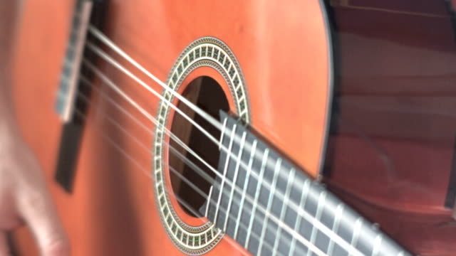 slow motion - guitar player close up - musical instrument string stock videos and b-roll footage
