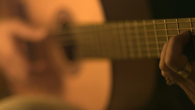 slow motion guitarist playing classical acoustic guitar, spain (individual frames may also be used as a still image. each frame in its raw state is about 6mb or about 12mb as a 16 bit tiff) - griffbrett stock-videos und b-roll-filmmaterial