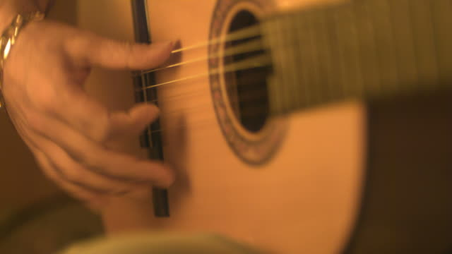 slow motion guitarist playing classical acoustic guitar, spain (individual frames may also be used as a still image. each frame in its raw state is about 6mb or about 12mb as a 16 bit tiff) - string instrument stock videos and b-roll footage