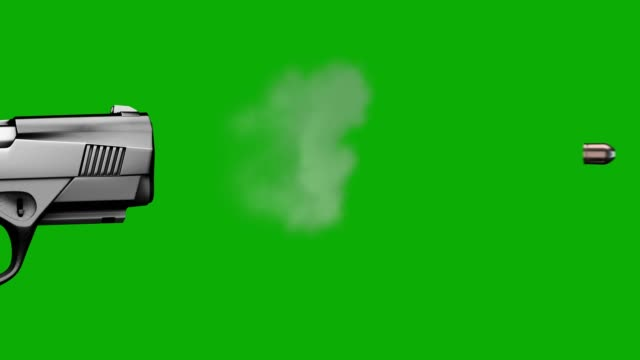 slow motion gun fire on green chroma screen - arma da fuoco video stock e b–roll