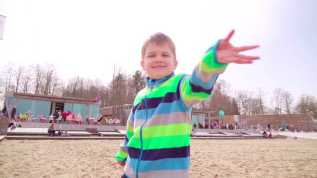 slow motion: happy boy waving hands - blond hair stock videos & royalty-free footage