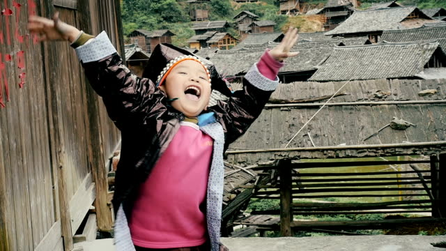 slow motion happy village boy cheering up - east asian ethnicity stock videos & royalty-free footage
