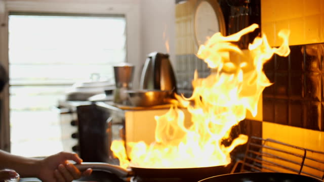 slow motion hd : flaming beef in skillet - kitchen stock videos & royalty-free footage