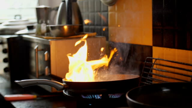 Slow Motion HD : Flaming Beef In Skillet