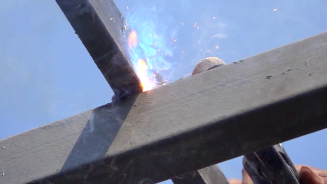 Slow motion HD: Sparkling with iron welding smoke.