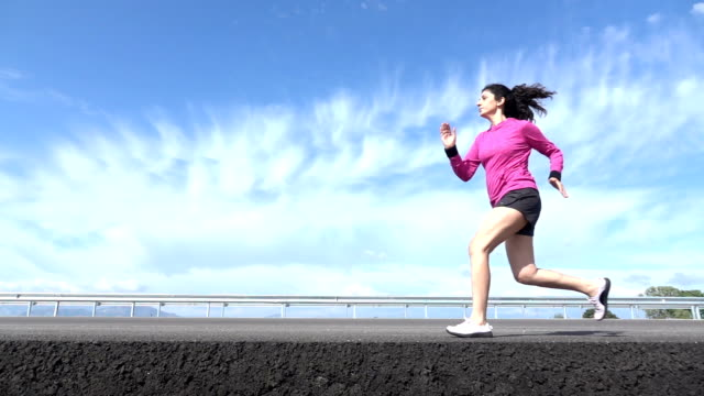 Slow Motion HD Video Of Adult Woman Running On Asphalt Road