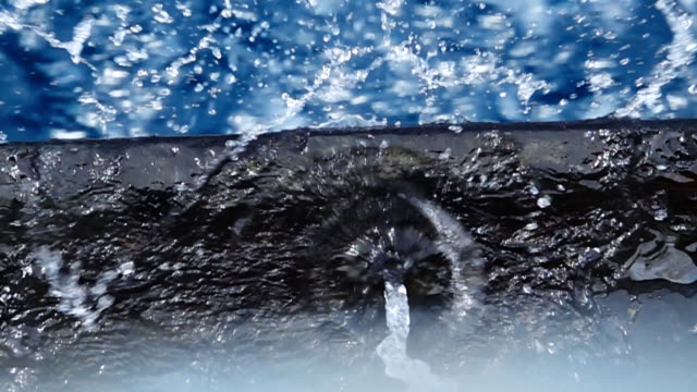 slow motion hd:water drainage from fishing boat into the sea - drainage stock videos and b-roll footage