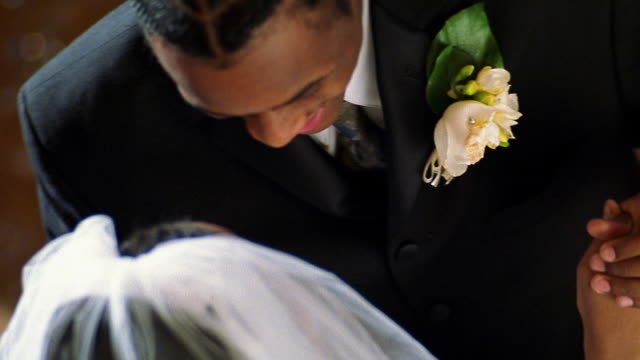 Slow motion high angle close up Black bride and groom dancing