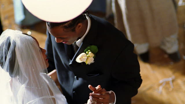 slow motion high angle close up black bride and groom dancing - wedding stock videos & royalty-free footage