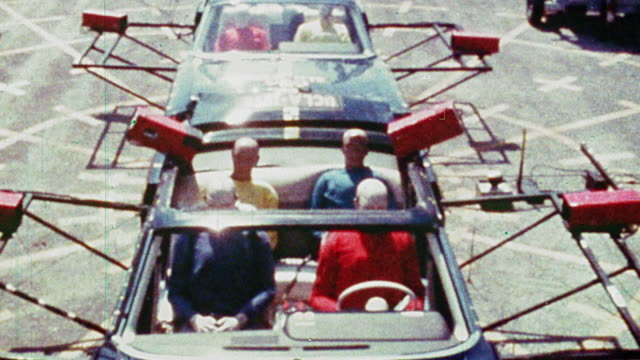 1968 slow motion high angle convertible car with test dummies is rear ended by another car during crash test - crash test stock videos & royalty-free footage
