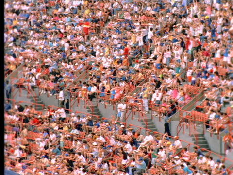 "slow motion high angle pan of crowd doing ""the wave"" in shea stadium / long island, ny - shea stadium stock videos and b-roll footage"