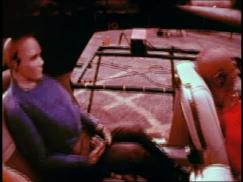 1968 slow motion high angle dummies in car getting whiplash in collision during safety test / educational - testdocka bildbanksvideor och videomaterial från bakom kulisserna
