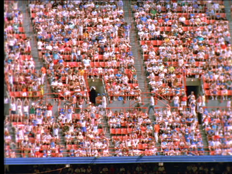 "slow motion high angle of crowd doing ""the wave"" in shea stadium / long island, ny - shea stadium stock videos and b-roll footage"