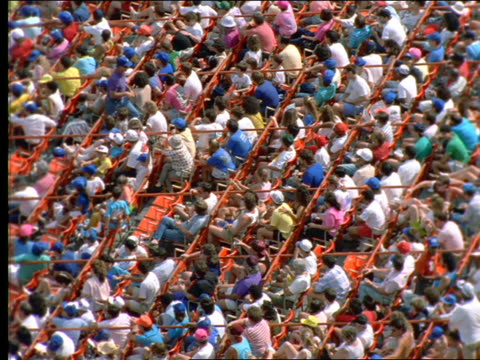slow motion high angle of crowd sitting in shea stadium / long island, ny - shea stadium stock videos and b-roll footage