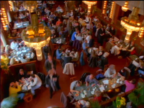 slow motion high angle tilt up busy cafe at municipal house / prague, czech republic - stare mesto video stock e b–roll