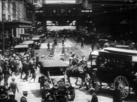 b/w 1906 slow motion high angle traffic + pedestrians on busy new york city street - 1906 stock-videos und b-roll-filmmaterial