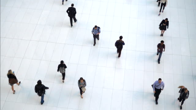 slow motion high angle view crowd walking people - corporate business stock videos & royalty-free footage