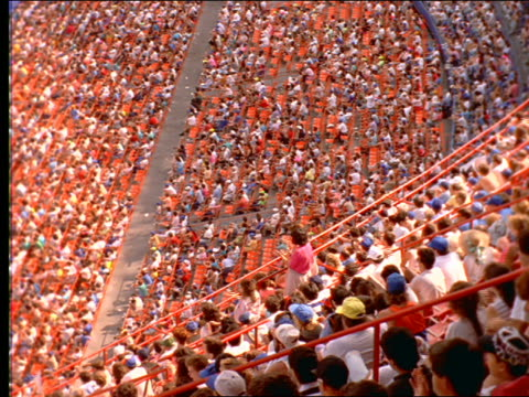 slow motion high angle wide shot of crowded shea stadium / long island, ny - shea stadium stock videos and b-roll footage