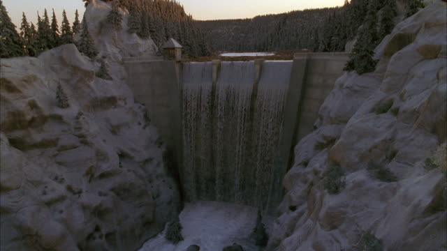 slow motion high angle wide shot water flowing over dam / dam breaking - dam stock videos & royalty-free footage