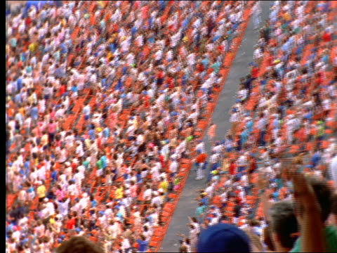 slow motion high angle zoom out + pan of cheering crowd in shea stadium / long island, ny - shea stadium stock videos and b-roll footage