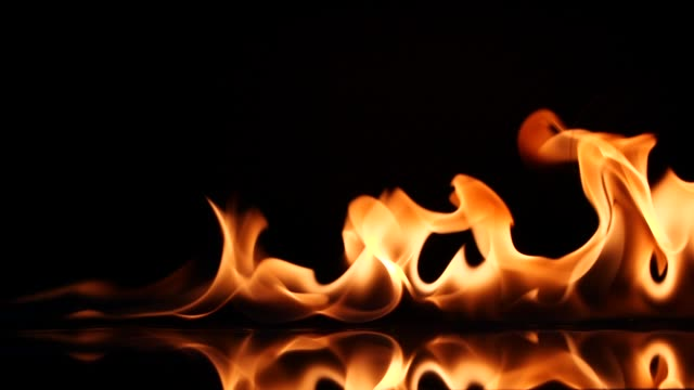 slow motion igniting and burning fire flame line - flame stock videos & royalty-free footage