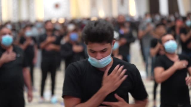 slow motion images show iraqi shiite muslims beating their chests to commemorate the start of the month of muharram, the first month of the islamic... - shi'ite islam stock videos & royalty-free footage