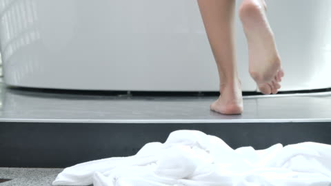 4k slow motion in the morning, the woman walked to the bathtub and took off the white robe to take a shower. - cleaning stock videos & royalty-free footage