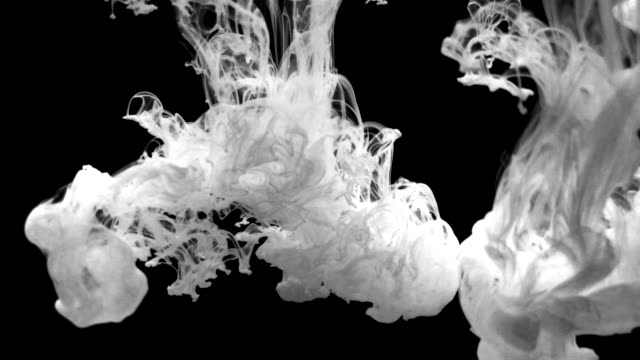 vídeos de stock e filmes b-roll de slow motion ink drops expands and swirls in water beautiful background - morphing