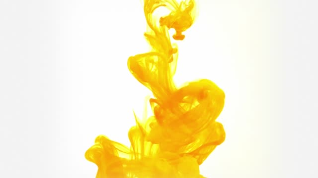 slow motion ink flow in water - yellow stock videos & royalty-free footage