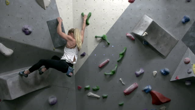 slow motion interior shots of shauna coxsey a member of team gb for the tokyo 2020 summer olympics at rock climbing training shot on january 13th 2020 - rock climbing stock videos & royalty-free footage