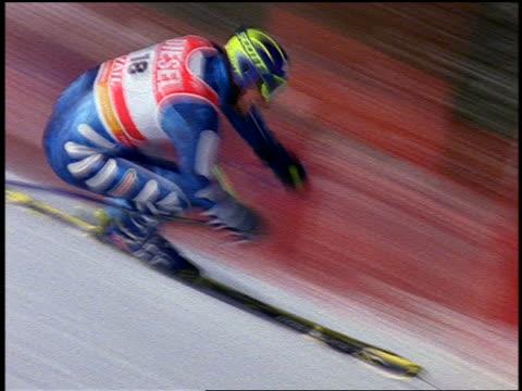 slow motion PAN Italian downhill skier speeding down steep slope past camera / Colorado