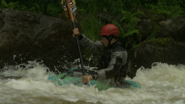 Slow motion kayaker by rockface, UK (Individual frames may also be used as a still image. Each frame in its raw state is about 6MB or about 12MB as a 16 bit TIFF)