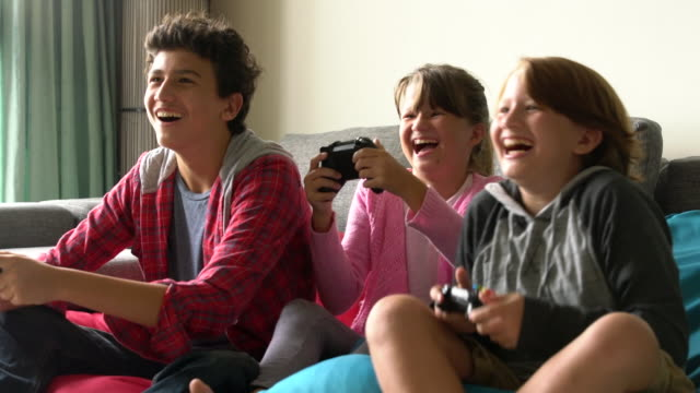 WS slow motion kids having fun playing video games.