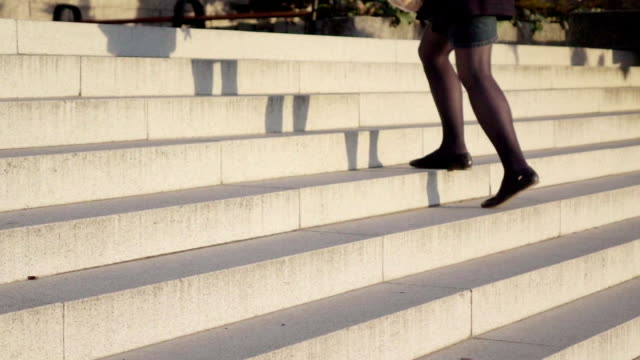 Slow motion: Lady legs on a stairs
