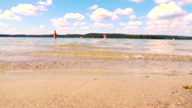 slow motion: lake beach - taking a bath stock videos & royalty-free footage