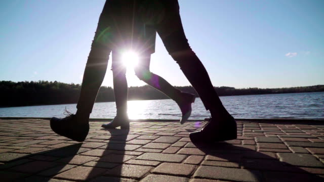 slow motion: legs on sunset and lake - unrecognisable person stock videos and b-roll footage